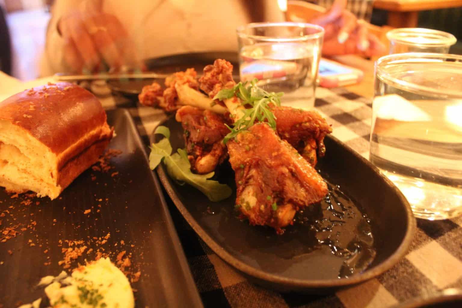 Crispy duck wings lemon, olive oil + yuzu kosho